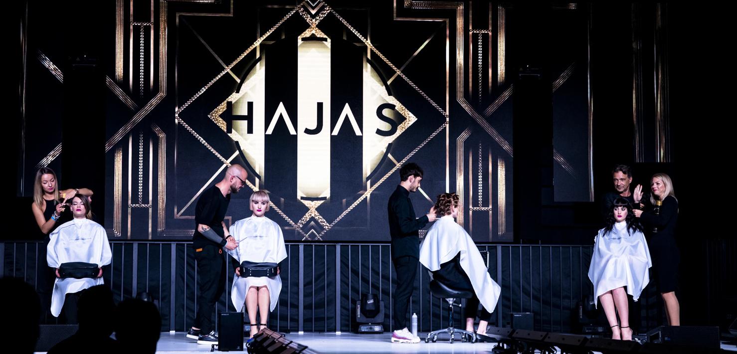 BUDAPEST HAIR SHOW- Együtt. Egy helyen. A fodrászatnak hódolva.<br /> <br /> A Budapest Hair Show fodrász esemény színpadán: a HAJAS kreatív csapat look & learn nagyszínpadi oktatása során két korszakot, két teljesen különféle világot mutatott be, mely a POSTER nevet viselte, aminek inspirációs témája az alkalmazott grafika szemszögéből az Art Deco & Pop art volt. <br /> <br /> Majd hála, köszönet és a magyar fodrászokhoz való tartozás jelent meg a színpadon a L'Oréal Professionnel nagykövetének showműsorában. Egy nemzetközi karrier és hírnév útját bejárva a HAJAS Alternative Best Of London show az angol fellépések legszebb pillanatait foglalta össze a magyar szakmai közönségnek.<br /> <br /> A Budapest Hair Show olyan inspirációs forrás, ami hónapokra feltölti a művészeket a színpadon és a közönség soraiban egyaránt és új célokat ad minden fodrász számára. A fodrász eseményen a HAJAS brand által fémjelzett produkciók HAJAS László, a Hajas Szalonok kollégái- Dudás Attila, Rácz Böbi, Gyuris Nikolett, Szalamonidesz Nikosz, Veszelovszky Norbert, Kovács R Ádám, Kecskés Dominika, Bruckner Alexa, Nyitrai Gabi, Papp Dorián, Koleszár Andrea, Mohácsi Jenő- , a L'Oréal Professionnel oktató fodrászai - Vörös Tamás és Dalotti Gergő- , Mali Ildi koreográfus, Sipos Zita sminkes, Gubán Bíborka sminkes, Stylist asszisztens- Pogoszov Natália, ruhák: Ferencz  Borbála , Peter Mero, visual: Bossányi Gergő, zene: d-Ots Farkas Péter közreműködésével jöttek létre. A Hajas Lászlóval készült riportfilmet a BWNET- Győri Szabolcs készítette.
